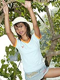 18 year old Thai teen plays in a tree by the sea from Tussinee